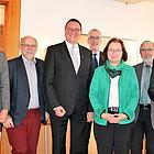 Gruppenbild mit neun Personen von links nach rechts: Dr. Harald Clausen, Clarissa Graz, Bernd Böttner, Prof. Dr. Martin Hein, Jörn Dulige, Ulrike Scherf, Dr. Volker Knöppel, Dr. Volker Jung, Heinz Thomas Striegler.